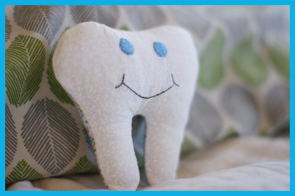 Free in the hoop smiling tooth fairy pillow machine